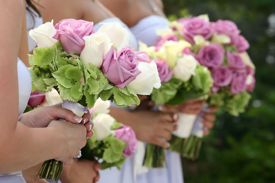 bigstock-Bridesmaids-Holding-Bouquets-3225865
