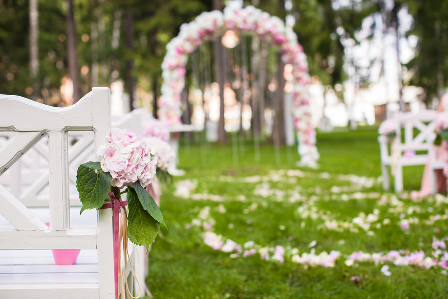 bigstock-Wedding-Benches-And-Flower-Arc-55257380